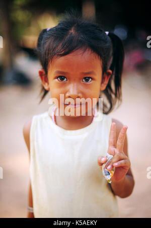SIEM REAP, CAMBODIA - Feb 8,2013:A Cambodian little girl close portrait in a village near Siem Reap. - Stock Photo