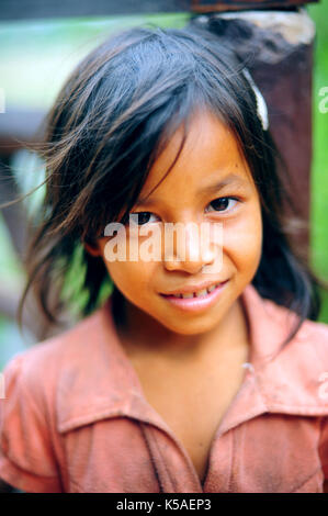 Siem Reap,Cambodia - Feb 9,2013:Little girl smiling at a Village of Siem Reap,Cambodia. - Stock Photo