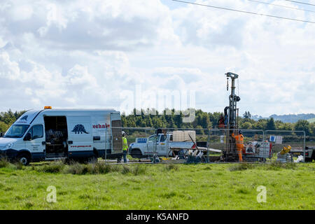 Workmen use a boring machine to extract soil samples on behalf of the National Grid - Stock Photo