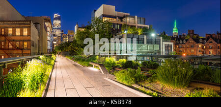 Panoramic view of the High Line promenade at twilight with city lights and illuminated skyscrapers. Chelsea, Manhattan, - Stock Photo