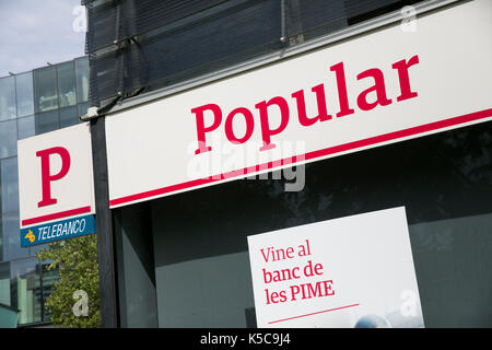 A logo sign outside of a Banco Popular branch in Barcelona, Spain on August 30, 2017. - Stock Photo