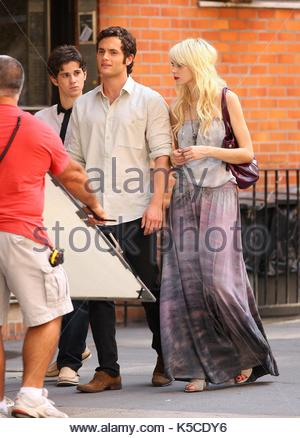 connor paolo and penn badgley on the set of gossip girl