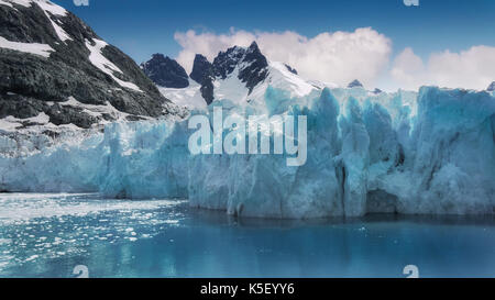Close-up view of turquoise ice of glacier face in Drygalski Fjord, South Georgia Island, in the South Atlantic Ocean. - Stock Photo