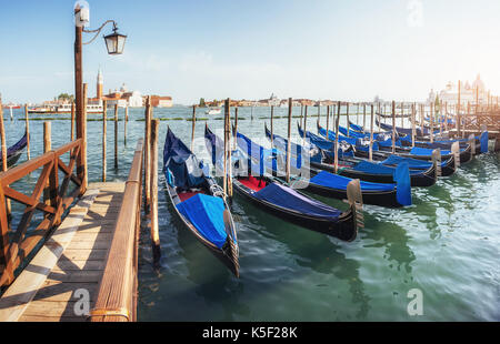 Gondolas in Venice - sunset with San Giorgio Maggiore church. San Marco, Venice, Italy - Stock Photo