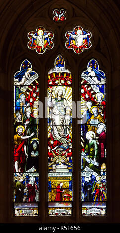 Stained glass cathedral church windows depicting religious scenes - Stock Photo