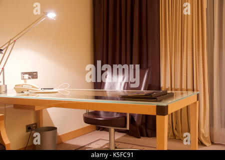 VIENNA, AUSTRIA - APR 28th, 2017: Compact modern office interior in the luxury five stars hotel with a working desk, - Stock Photo