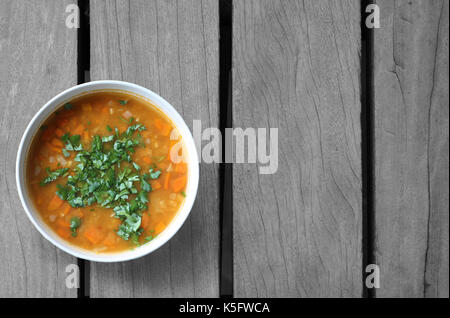 soup for the soul on wooden table - Stock Photo