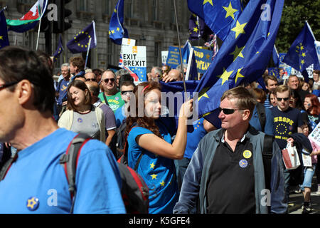 London, UK. 9th Sept, 2017. A young woman grapples with an EU flag while marching down Whitehall during the People's - Stock Photo