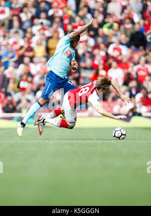 London, UK. 9th Sep, 2017. Nacho Monreal (R) of Arsenal is tackled during the English Premier League match between - Stock Photo