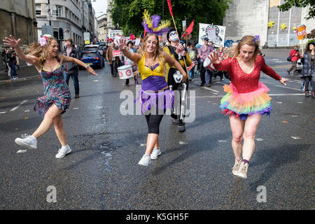 Bristol, UK, 9th September, 2017. Protesters dancing are pictured as they march through the city centre in an anti-austerity protest march and rally.  The protest was called for by Bristol Mayor Marvin Rees and was backed by the Bristol Labour Party, Green party and over 30 organisations, including trade unions and community groups to demanded that the Conservative government gives Bristol and other cities in the UK the funding needed for public services.