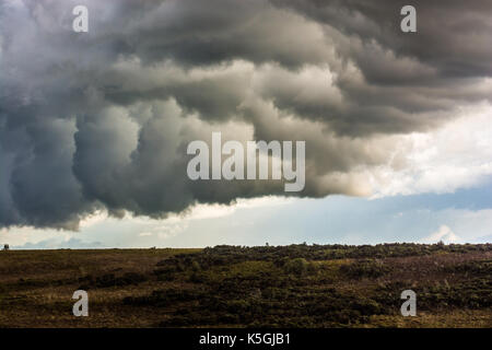 Deadman Hill, Godshill, New Forest, Hampshire, UK, 9th September 2017: Thunderstorm clouds spread slowly over the - Stock Photo
