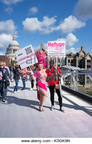 Millennium Bridge, London, UK. 9th Sep, 2017. Refuge supporter takes part in walk across the Milllennium Bridge - Stock Photo