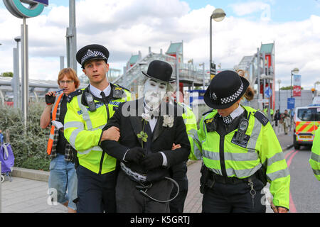 London, UK. 9th Sept, 2017. A man dressed as Charlie Chaplin is arrested after attempting to chain himself to a - Stock Photo
