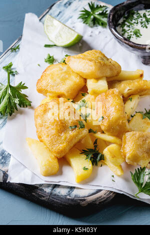 Fish and chips with sauce - Stock Photo