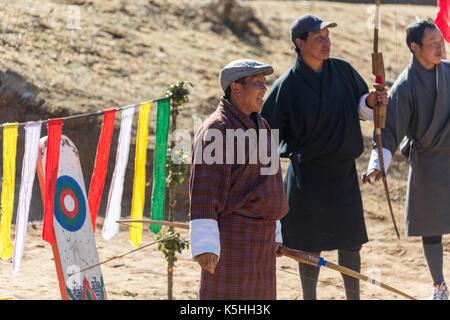Local archery competition in Phobjikha Valley, Western Bhutan - Stock Photo