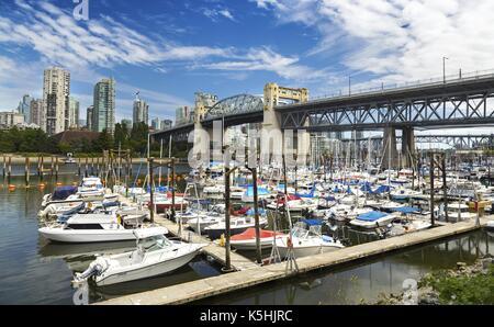 View of Burrard Street Bridge and Yachts in Vanier Park Marina from False Creek Seawall near Kitsilano Vancouver - Stock Photo