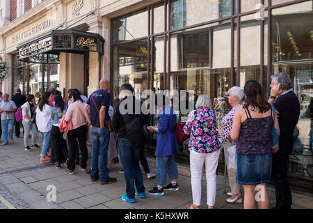 Queue of customers waiting outside Bettys tearooms in York Yorkshire, England, UK - Stock Photo