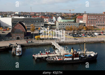 The port of Kiel, Germany between The Sweden Quay and the Baltic Sea Quay with the Maritime Museum front left - Stock Photo