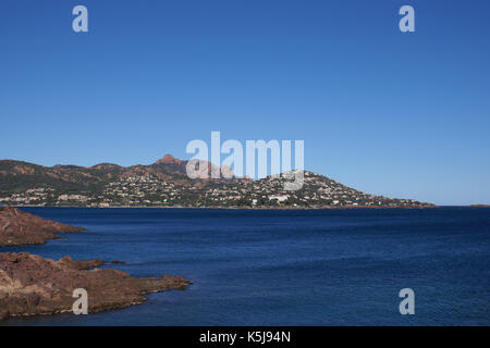 Red rock and blue sea for the Mediterranean coast in French Riviera. Esterel Coast - Stock Photo