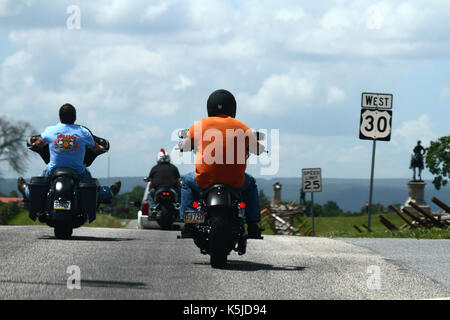 Bikers on the Lincoln Highway Route 30 pass battlefield monuments during Bike Week, Gettysburg, Adams County, Pennsylvania, - Stock Photo