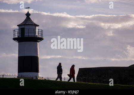 People taking a morning walk next to Southsea Castle - Stock Photo