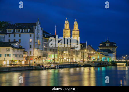 Night cityscape with Limmat river of the historical Zurich city, Switzerland - Stock Photo