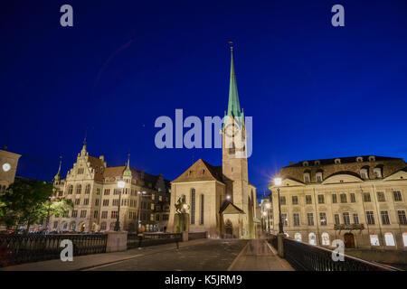 Night cityscape of Women's Minster, Zurich, Switzerland - Stock Photo