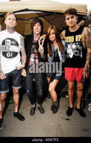 (L-R) Jona Weinhofen Oliver Sykes Bring Me Horizon,Demi Lovato guest Vans Warped Tour 2010 Seaside Park June 27,2010 - Stock Photo