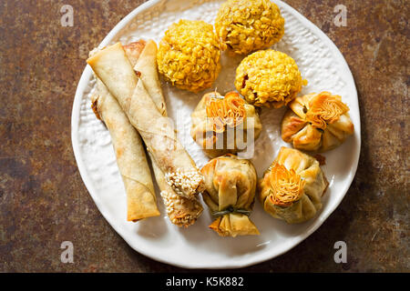 Duck party food selection. Sesame duck cigars, duck moneybags, crispy duck bonbons. - Stock Photo