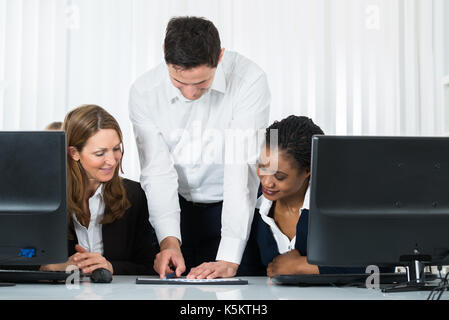 Group Of Multiracial Businesspeople Discussing On Graph In Office - Stock Photo