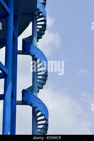 Close up of Blue Spiral Staircase on Elevated Water Tank - Stock Photo