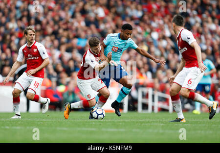London, UK. 9th Sep, 2017. Lys Mousset (2nd R) of Bournemouth vies with Shkodran Mustafi (2nd L) of Arsenal during - Stock Photo