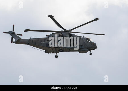 London, UK. 9th September, 2017. A military helicopter arrives at the ExCel Centre in advance of the DSEI arms fair. - Stock Photo
