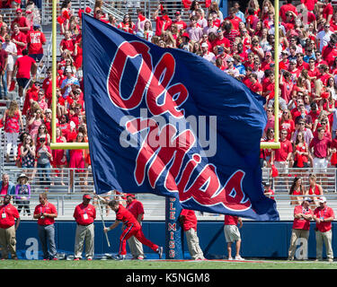 Oxford, USA.  9th Sept 2017. A University of Mississippi  chearleader carries a banner to celebrate a touchdown - Stock Photo