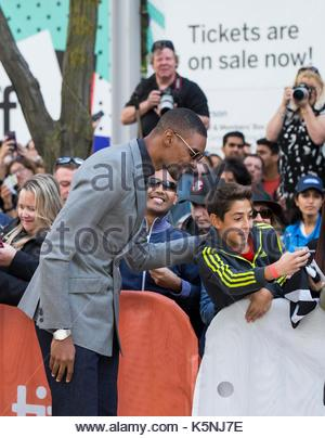 Toronto, Canada. 9th Sep, 2017. NBA player Chris Bosh poses for photos with fans during the world premiere of the - Stock Photo