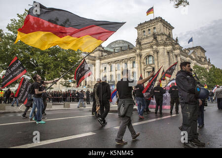 Berlin, Berlin, Germany. 9th Sep, 2017. Protesters march in fron of the Bundestag, the German Parliament in Berlin - Stock Photo
