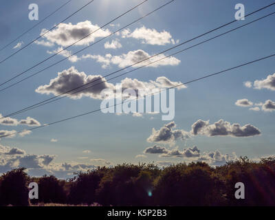 Electric wires low angle view on clear sky background. - Stock Photo