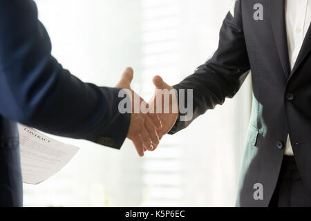 Business partners reaching consensus on meeting - Stock Photo