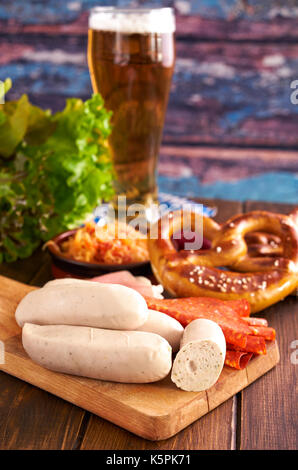 Oktoberfest food on wooden table - Stock Photo