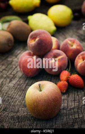 Healthy organic food. Fresh fruit on wood. - Stock Photo