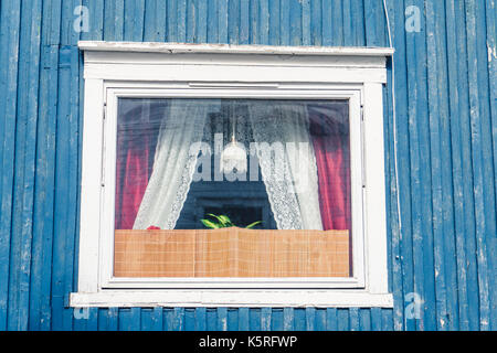 Window in a wooden house - Stock Photo