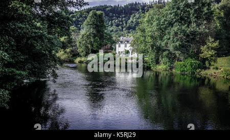 White house by the River Teith in Callander, Perthshire, near Stirling at Loch Lomond and the Trossachs National - Stock Photo