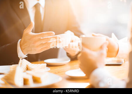Conducting Negotiations with Business Partner - Stock Photo