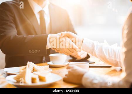 Firm Handshake of Business Partners - Stock Photo