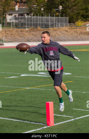 teen boy, teenage boy, boy, teenager, playing football, pick-up football game, San Marin High School, Novato, Marin - Stock Photo
