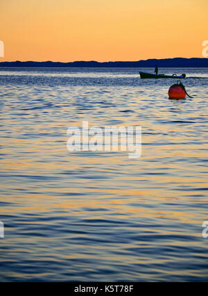 Fisherboat on the water Italien lake garda - Stock Photo