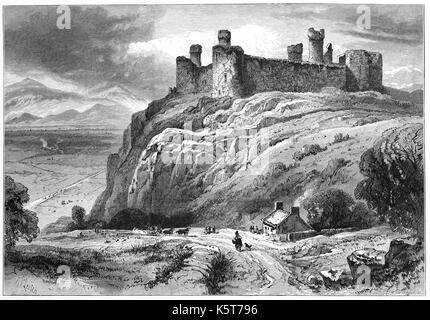 1870: Harlech Castle is a medieval fortification, constructed atop a spur of rock close to the Irish Sea. It was - Stock Photo