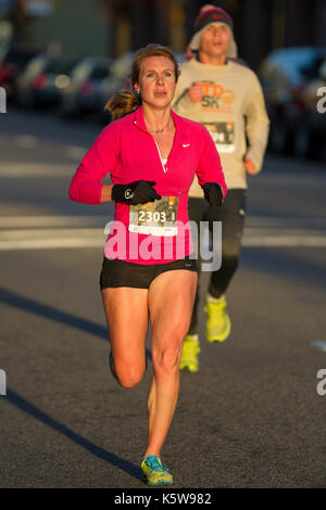 BOISE, IDAHO - NOVEMBER 22:  Runner 2303 racing in the Turkey Day 5k before the thanksgiving festivities begin in - Stock Photo
