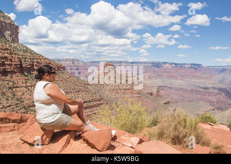 Asian woman enjoying the view of the Grand Canyon from the Bright Angel Trail - Stock Photo