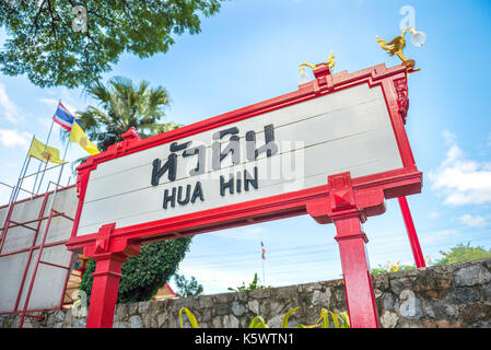 'HUA HIN' railway station sign post with red frame cover - Stock Photo